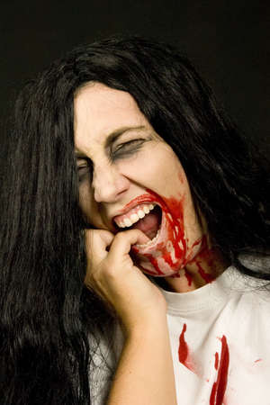 a screaming women, dressed for halloween Stock Photo - 7958098