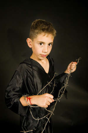 satanic: on boy with barbed wire, dressed for halloween.