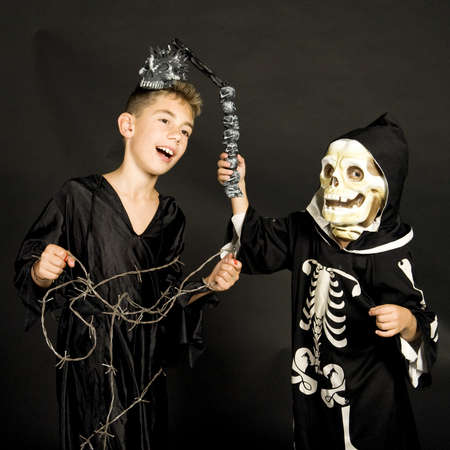 two children, dressed for halloween. photo