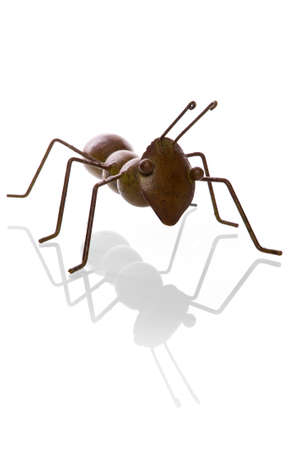 pismire: an ant, made of metal on a white background