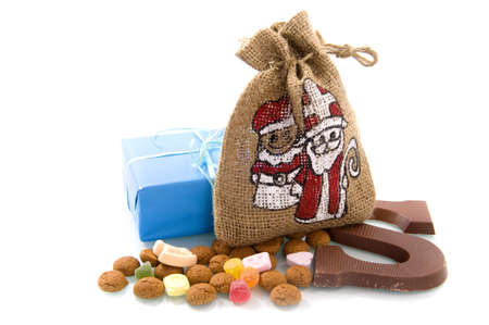 a bag, a present, nuts and a chocolate letter for sinterklaas, a dutch tradition photo