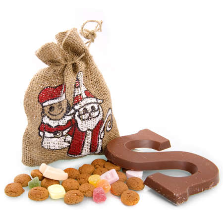 a bag, nuts and a chocolate letter for sinterklaas, a dutch tradition photo