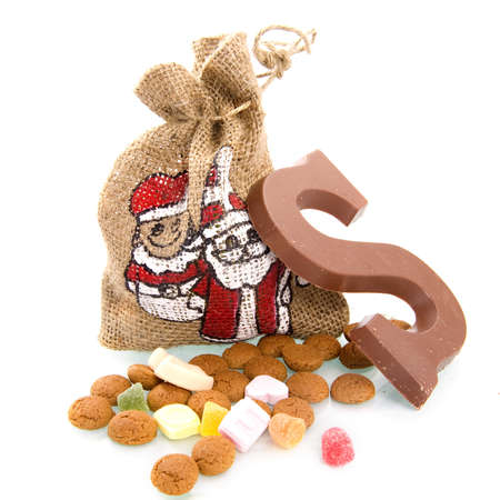 a bag, nuts and a chocolate letter for sinterklaas, a dutch tradition