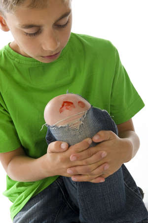 injure: a young boy with a painful leg on white Stock Photo