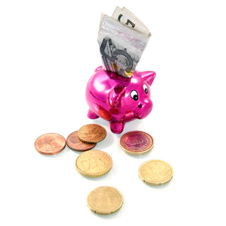 five euro banknote in a pink piggybank photo