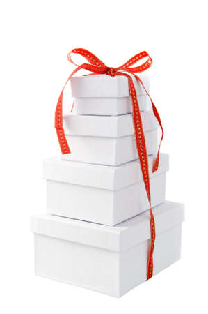 a pile of white presents with a red ribbon on a white background