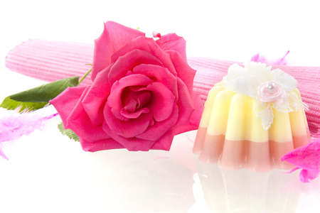 mariage: a rose and a soap pie on a white background