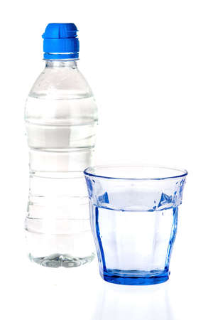 a blue glass and a bottle of water on a white background photo