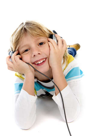 a boy listining to music with a headphone Stock Photo - 8791241