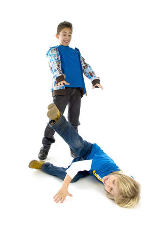The big brother is throwing his little brother on the ground Stock Photo