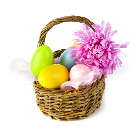a wicker basket with colored eggs for easter Stock Photo