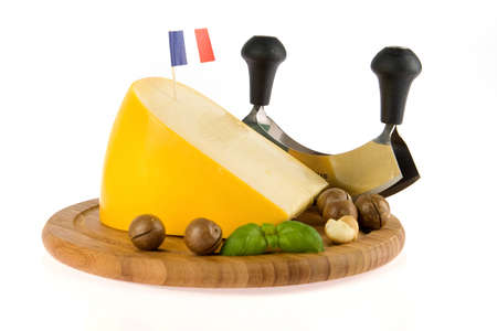 slicer: a kilogramm cheese, a chees slicer and nuts