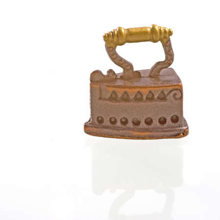 antik: an old fashioned iron, miniature
