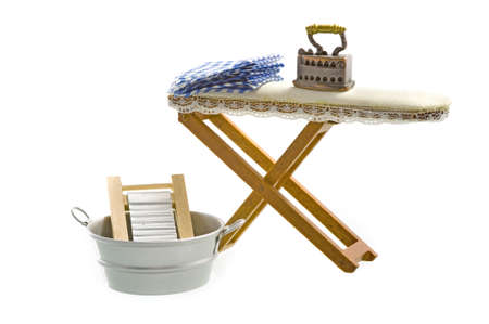 An old fashioned iron and ironing board photo