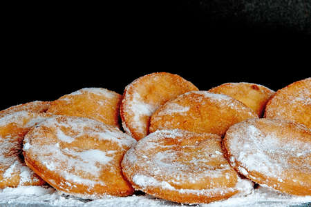 suger: a lot of dutch food, named appelbeignets with suger Stock Photo