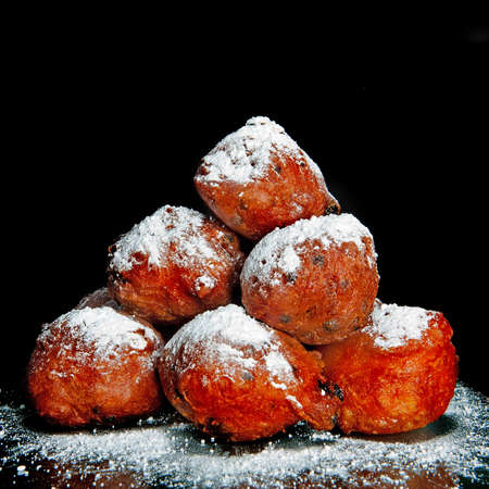 suger: a lot of dutch food, named oliebollen with suger Stock Photo