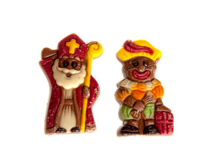 sint: a sint and piet made of chocolate, celebration a dutch holiday called Sinterklaas Stock Photo