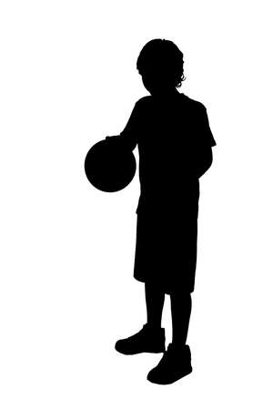 Silhouet of a boy, playing basketball