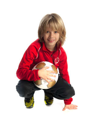 sweatsuit: a young boy, with a soccer ball Stock Photo