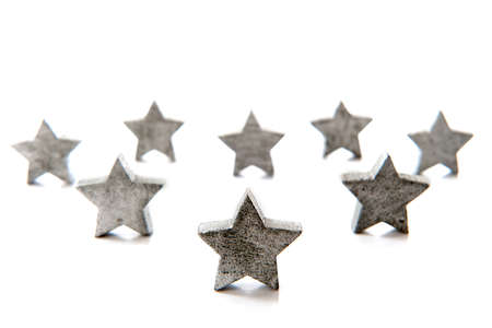 silver stars for christmas in a row on a white background