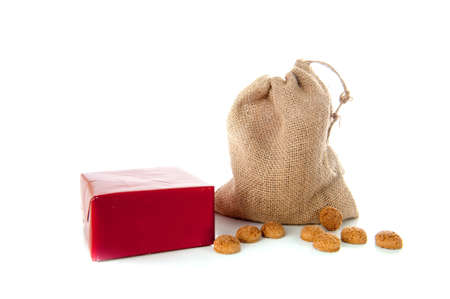 A jute bag full of pepernoten, for celebrating a dutch holiday  Sinterklaas   on the fifth of December photo
