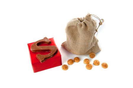 A jute bag full of pepernoten, a present and a chocolate letter, for celebrating a dutch holiday  Sinterklaas   on the fifth of December photo