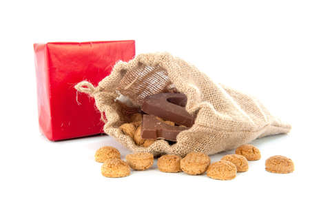 A jute bag full of pepernoten, for celebrating a dutch holiday ' Sinterklaas '  on the fifth of December photo