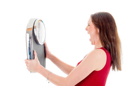 an angry girl with a weighing scale, on a white background
