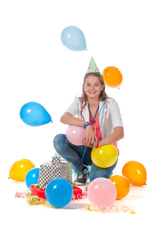 birthday party kids: a birthday girl with presents and balloons