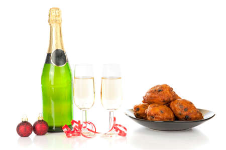 Celebrating new year with champagne and Oliebollen! Stock Photo