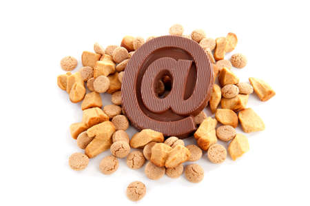 gingernuts: a atpersand, made of chocolate with a lot of ginger-nuts on a white background Stock Photo