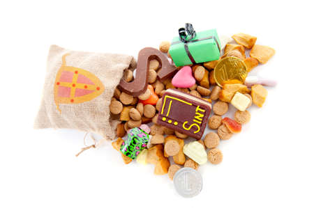 A jute bag full of pepernoten and other candy, for celebrating a dutch holiday  Sinterklaas   on the fifth of December photo