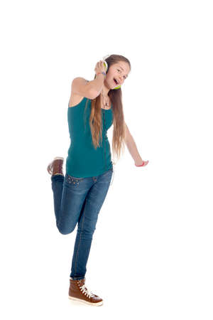 a happy teenager, listen to some music, on a white background Stock Photo - 25646615