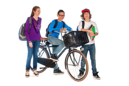 three young students, one with a bike are talking, on a white background photo