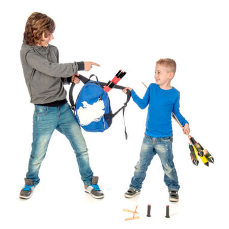 he said: No fireworks for such a young boy! De teenage boy said to the little boy that he cant have firework! Stock Photo