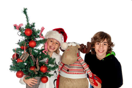 Two boys - one with a decorated christmas tree -and a Christmas Reindeer. photo