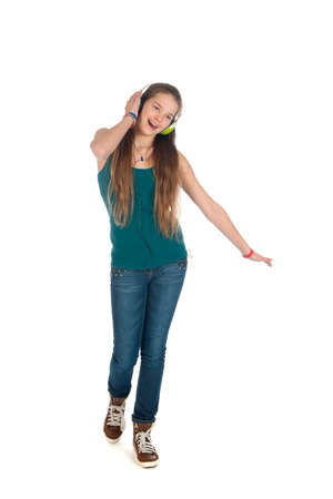 a happy teenager, listen to some music, on a white background Stock Photo - 25646698