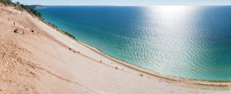 overlook: Tourists climbing up and down a popular dune overlook at Sleeping Bear Dunes. Stock Photo