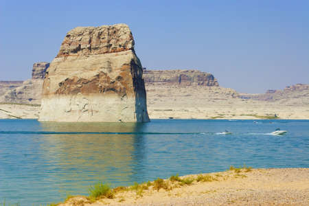 lake powell: Boaters driving around Lone Rock on Lake Powell, Page, Arizona Stock Photo