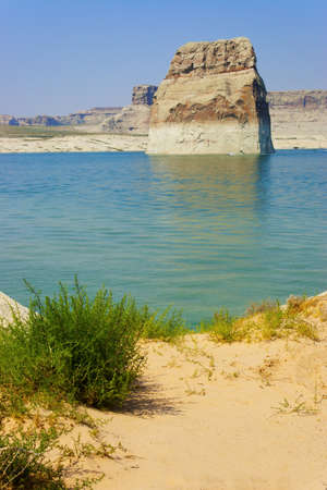 Boaters driving around Lone Rock on Lake Powell, Page, Arizona  photo