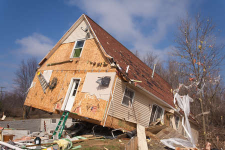 LAPEER COUNTY, MI - MARCH 16  A home heavily damaged by an F2 tornado that swept through Oregon Twp in Lapeer County, MI on March 15, 2012  The house was lifted from its foundation