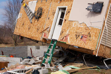 LAPEER COUNTY, MI - MARCH 16  A home heavily damaged by an F2 tornado that swept through Oregon Twp in Lapeer County, MI on March 15, 2012  The house was lifted from its foundation  Stock Photo - 12926372
