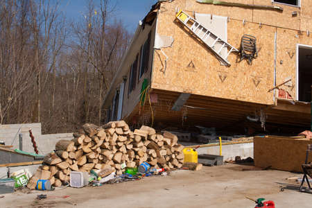LAPEER COUNTY, MI - MARCH 16  A home heavily damaged by an F2 tornado that swept through Oregon Twp in Lapeer County, MI on March 15, 2012  The house was lifted from its foundation  Stock Photo - 12926371