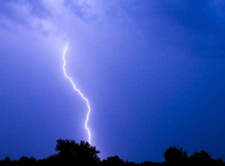 Single bolt of lightning in a thunderstorm  Фото со стока