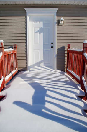 Snow covered porch that needs to be shoveled Stock Photo - 16033480