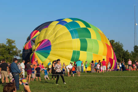 METAMORA, MICHIGAN - AUGUST 24 2013  Colorful hot air balloons launch at the annual Metamora Country Days and Hot Air Balloon Festival