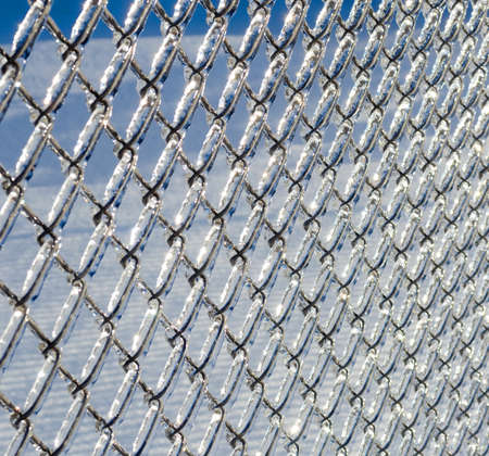 Ice covered chain link fence from a severe icestorm.