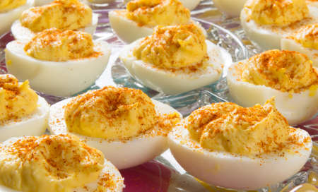 Several Deviled Eggs topped with paprika