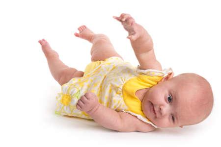 Leuke baby rollen over geïsoleerd op een witte achtergrond Stockfoto