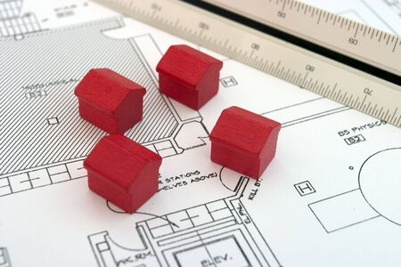 house exchange: Four houses and scalimeter Stock Photo